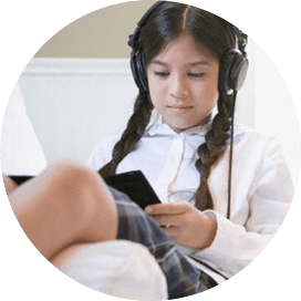 Picture of a girl listening to an audio book.